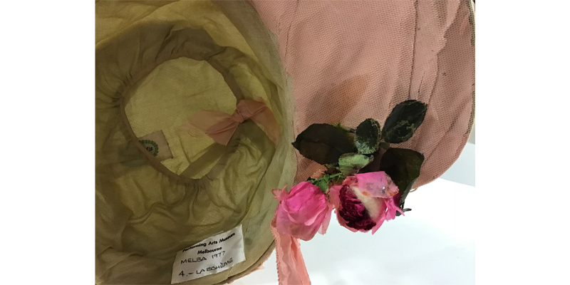 Detail of tulle covering the silk lining and reshaped flowers