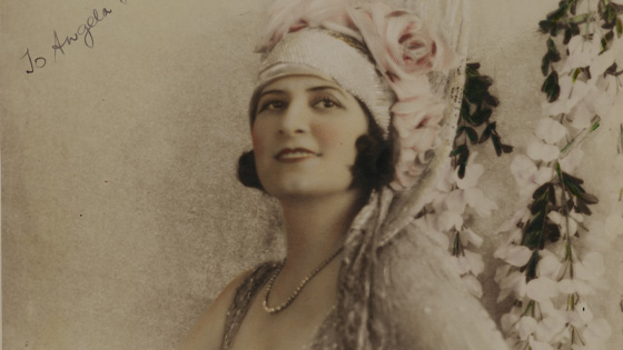 A hand-coloured photo of Gladys Moncrieff