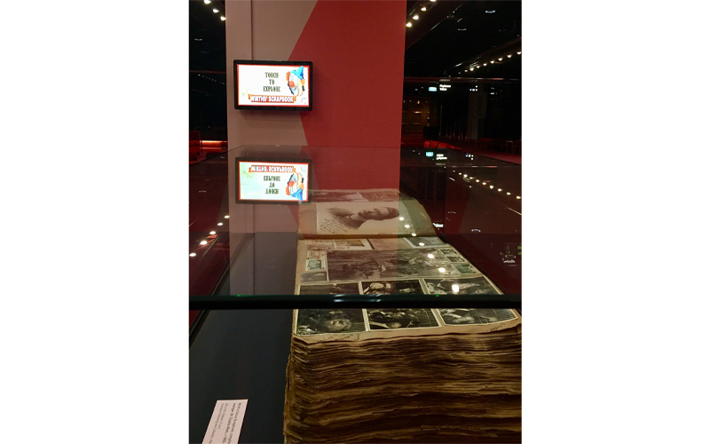 Wirth's scrapbook on display with the touchscreen