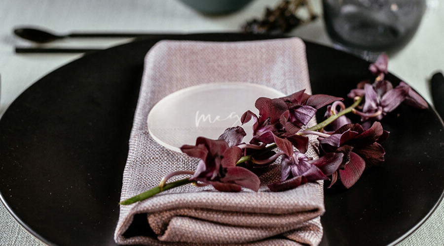 A place setting in purple and charcoal
