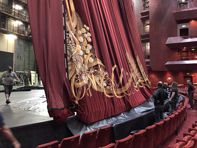 Production crew lowering the curtain