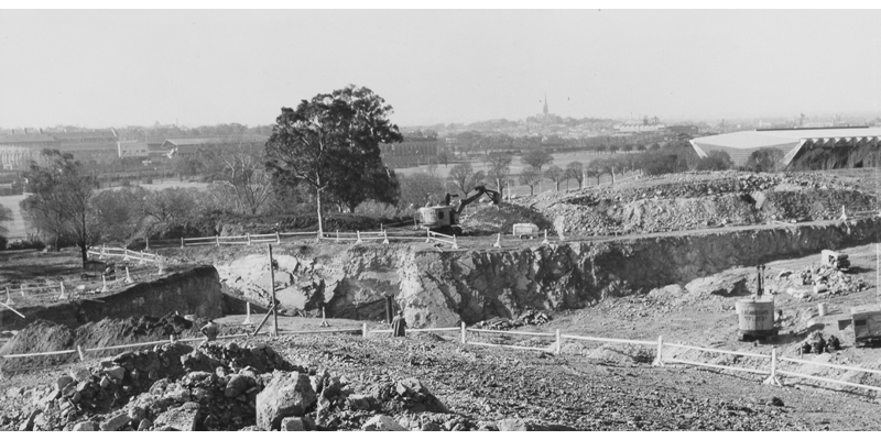 Excavation for the Sidney Myer Music Bowl, with the Olympic Swimming Pool in the background